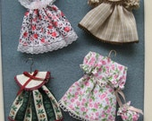 Little girls outfits to lay on a bed, chair or hang in a closet in a dollhouse or room box.