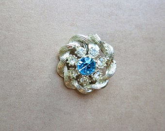 Vintage silver-toned round sparkly brooch