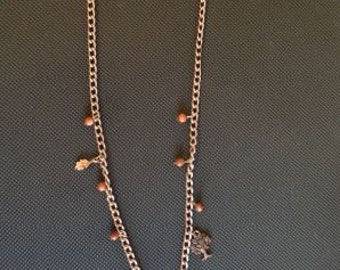 Goldstone and copper butterfly necklace