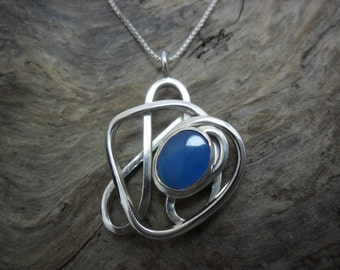 Sterling silver set of a blue onyx pendant.
