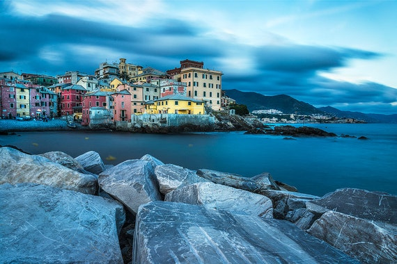 Boccadasse is a small fishing village in Genoa, Italy that lies at the eastern side of the Corso Italia stroll which is the main sea front stroll. It is one of the most beautiful and romantic places in Genoa, with its old colored houses and boats lining the shore.