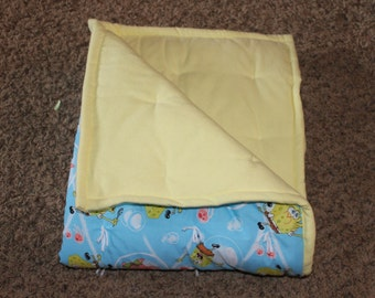 Sponge Bob Square Pants. Cute cotton with flannel bottom, for a warm blanket to snuggle in.