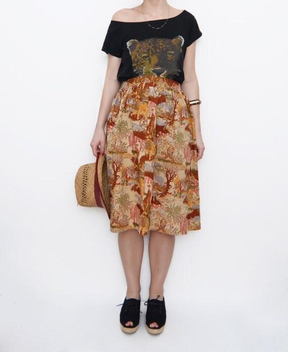 Vintage safari mid length orange skirt / africa / animal print / nature earth tones