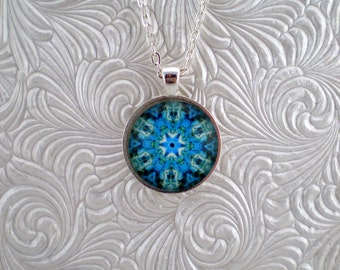 Light blue and green abstract kaleidoscope pendant necklace