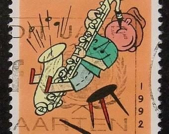 Boy with saxophone Nederland -Handmade Framed Postage Stamp Art 11542