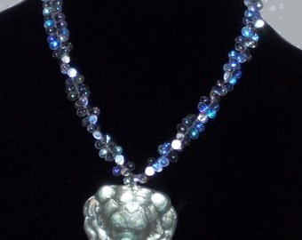 "Authentic movie artifact Lion necklace made from ""It's a Mad, Mad, Mad, Mad World"" car glass."