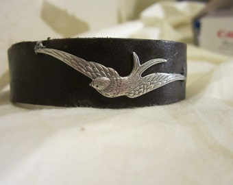 leather wrist cuff with silver swallow