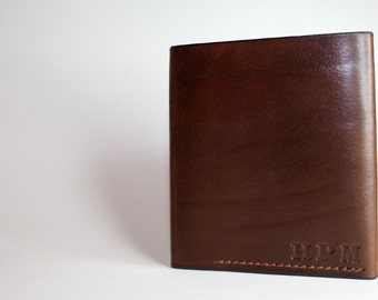 Handmade chocolate/natural leather two tone bifold veg tan wallet.Classic design that will get better with age.Can be personalised/monogram