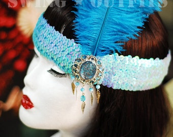 1920s style light blue flapper headband with a feather