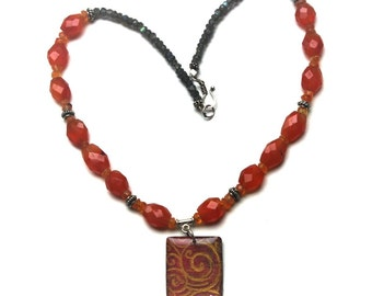 labradorite and carnelian necklace with polymer clay pendant in orange and gray