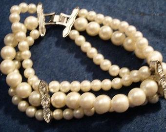 VINTAGE 3 strand faux cream pearl bracelet with rhinestone spacers