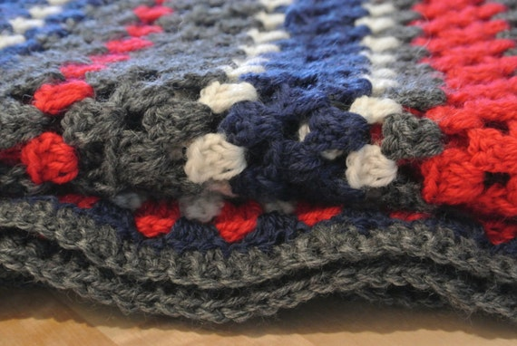 Red, white, blue and grey crochet blanket
