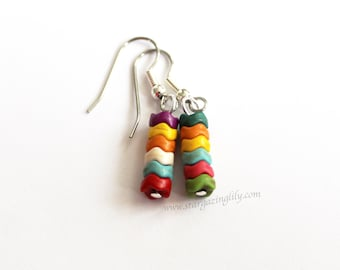 Geometric Wavy Colorful disc earrings. Rainbow Stripes. Lightweight beads on hypoallergenic surgical steel hooks.