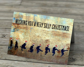 Ministry of Silly Christmas - Monty Python's Ministry of Silly Walks red santa hats stencil graffiti humor funny street art 70s tv handmade