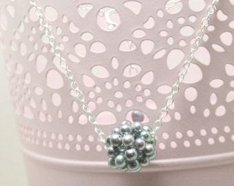 Snowball with silver chain e