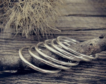 Six slim sterling silver stacking rings