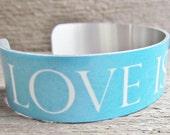 BLUE Bracelet Quote Love Is A Verb Art Cuff Printed Aluminum MEDIUM Waterproof Durable Jewelry Travel Cruise Lightweight M201
