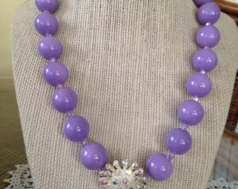 Large Purple Beaded Necklace with Vintage Aurora Borelas Earring at Center