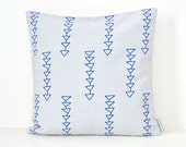 Light grey linen pillow cover with geometric tribal design in Mediterranean blue