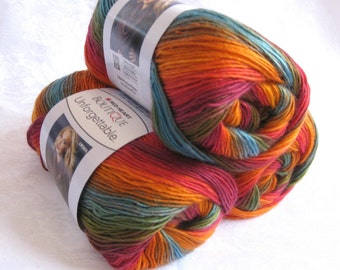 Boutique Unforgettable yarn in SUNRISE, rainbow shades of reds, orange, blue, green,  worsted weight, Red Heart Boutique