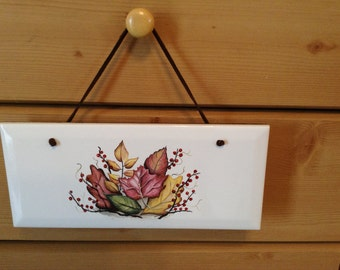Ceramic Plaque  it is 4 1/4 by 10 With Fall Leaves