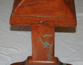 Mesquite Wood Saddle Stand with turquoise filling the wind splits and worm holes.