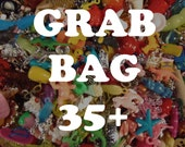 Incredible Grab Bag of charms, beads, trinkets, nic-nacs, doodads (qty 35)
