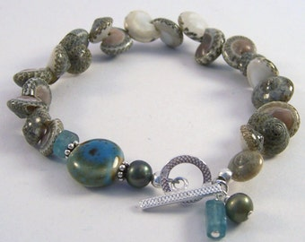 She Sells Seashells.. Natural shell, apatite and ceramic bracelet, sterling silver