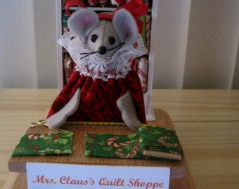 Felt Christmas Mouse in Mrs Claus Quilt Shop  by Attic Mouse