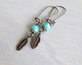Mila. Brass and turquoise bead, brass feather earrings