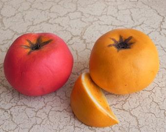 porcelain red tomato and a half orange tomato sculptures