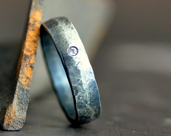 sterling silver man's ring band with flush set diamond and hammered organic texture, distressed satin finish