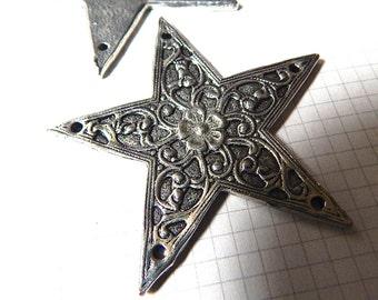 Large Metal Star with Filigree Pattern