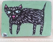 Tiny little black cat painting on found wood in folk art style