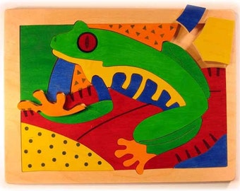 Wooden frog puzzle etsy for Decorative pond fish crossword clue