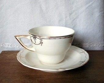Lovely Cream Crown Pottery Cup and Saucer with Gold Trim