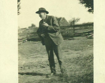 Still Talking Happy Old Farmer Man Holding Pipe Not Posing For Picture RPPC Real Photo Postcard Vintage Antique Black White Photo Photograph