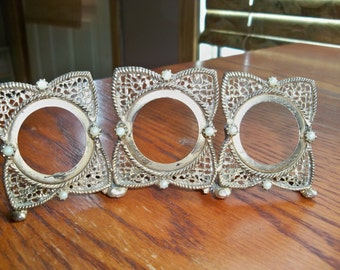 fancy triple frame with attached stand  for tiny round photos