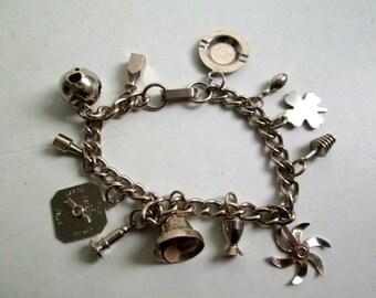 Vintage Charm BRACELET. Silver tone metal with 11 charms.  1960's.  Fabulous
