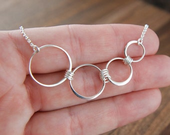 Graduated four circle infinity necklace in sterling silver, entwined rings, interlocking circles, four circles mother's day