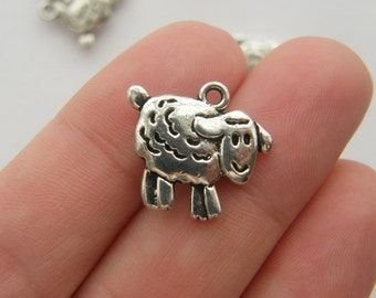 8 Sheep charms antique silver tone A101