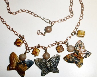 Stone butterfly necklace with quartz beads and copper