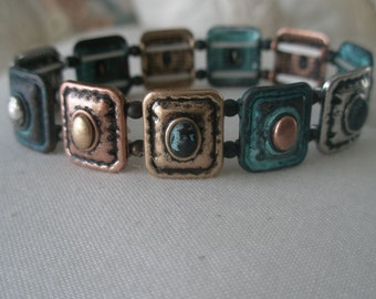 Vintage Expandable Bracelet of Multi Metal Shields with Semi Precious Stone Centers