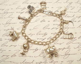 Vintage Silver 1950s Charm Bracelet 9 Charms with Moving Wheels Assorted Theme