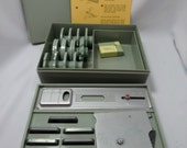 Kenmore Buttonholer #31445, Sewing Cams and Needle Threader in 2 tier stacking plastic storage box