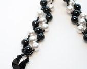 black and white bracelet . swarovski pearl . pearl bracelet . stripe . black . white .