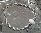 Kumihimo Bracelet - Gray & White with White Faceted Glass Bead and Silver-Toned Toggle Closure - 8 Strand