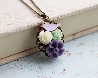 Garden Necklace. bird in garden necklace. pink little bird with violet, ivory, and mint flower necklace. lovely necklce