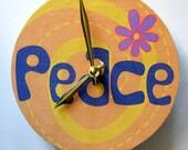 Small wall clock.  1960s Hippy Peace Sign.