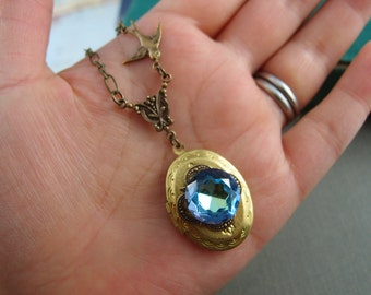 Vintage bermuda blue glass jewel vintage locket, aged brass locket, oval locket, N020